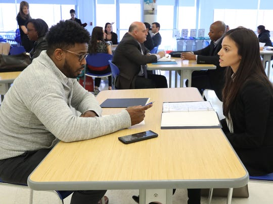 Cynthia Benitez of Monroe is interviewed by Tesfa Stewart of the Hastings-on-Hudson School District during the Quad Village Diversity Career Fair at Dobbs Ferry High School April 18, 2018.