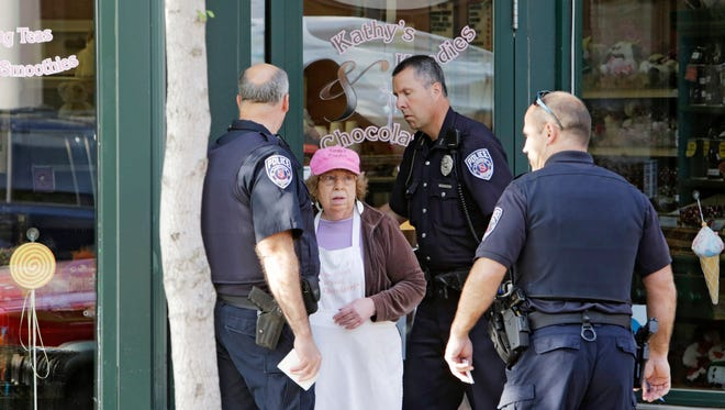 Lafayette police arrive Friday, May 8, 2015, at Kathy's Kandies in Lafayette after a reported armed robbery. The store's owner, Kathy Logsdon, center, said a woman entered the store, displayed a knife, demanded cash and fled on foot.