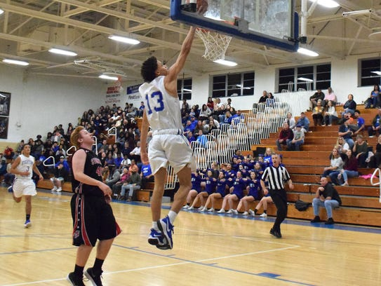 Robert E. Lee's Darrion Simms sails in for a layup