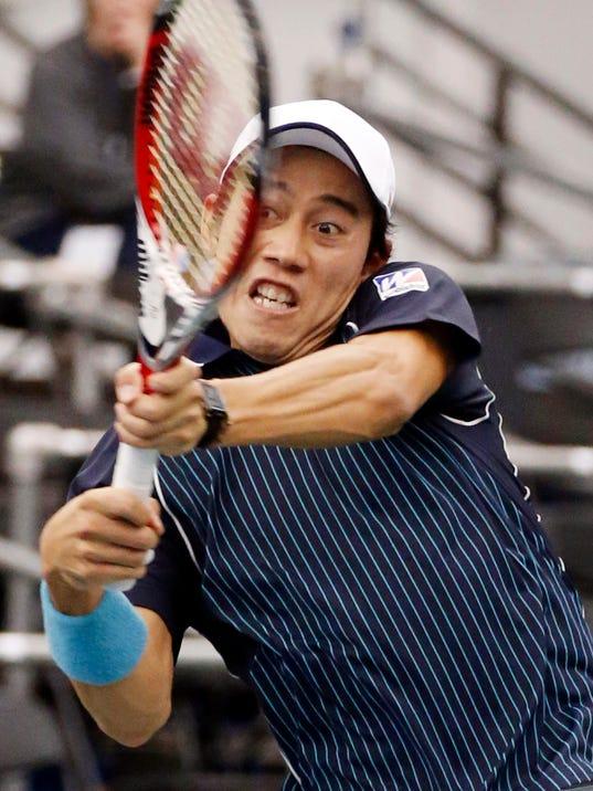 Kei Nishikori,of Japan, hits a return to Ivo Karlovic, of Croatia, in the singles final at the U.S. National Indoor Tennis Championships on Sunday, Feb. 16, 2014, in Memphis, Tenn. (AP Photo/Rogelio V. Solis)