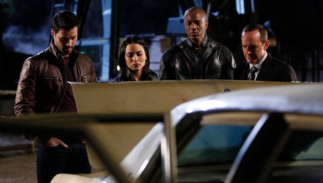 "Brett Dalton (far left), Maya Stojan, J. August Richards and Clark Gregg in a scene from ""Marvel's Agents of S.H.I.E.L.D."""