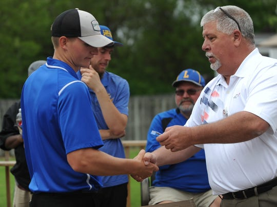 Lincoln High School athletic director Rob Bills, right, awards Centerville's Mason Rader the TEC tournament medal Saturday, May 21, 2016 at Winding Branch Golf Course in Pershing.
