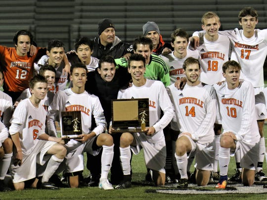 Northville players celebrate their first-ever KLAA
