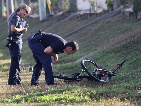 Forensic Technician Lisa Lansky and Major Crash Investigator, Officer Nick Green investigate the scene of a fatal hit and run crash on the eastbound lane of Pine Island Road just west of Del Prado Boulevard Monday (2/2/15) morning. The victim was believed to have been struck while riding a bicycle.