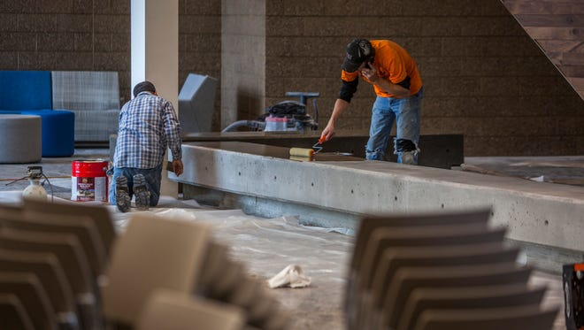 Construction workers put the final touches on the new Southwest Applied Technology College building, Tuesday, Dec. 22, 2015.