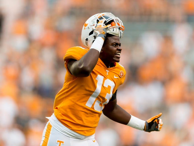 Tennessee defensive lineman Deandre Johnson (13) reacts