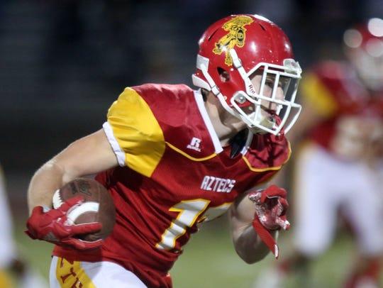 Palm Desert's Brooks Stephenson carries the ball against