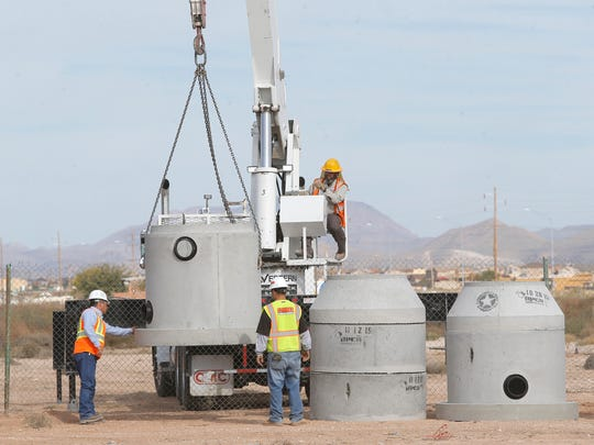 Underground piping is unloaded at the Pebble Hills Boulevard extension project site in far East El Paso.