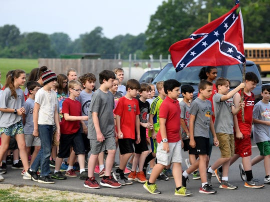 Medina Middle School fifth graders march to their places as they portray confederate soldiers during a civil war re-enactment, Thursday morning, May 17.