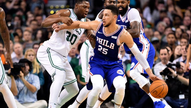 Philadelphia 76ers guard Ben Simmons (25) dribbles to the basket and is defended by Boston Celtics forward Guerschon Yabusele (30) during the first half at the TD Garden.