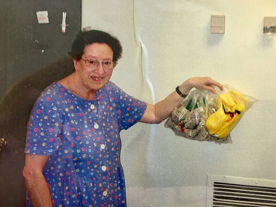 Ruth Kramer of Bound Brook delivering a batch of her colorful hand-knit slippers to the hospital in 2004.