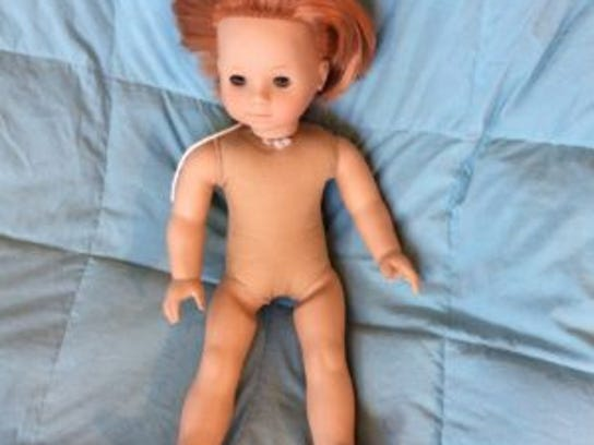 This doll came to me with chopped off hair and stains