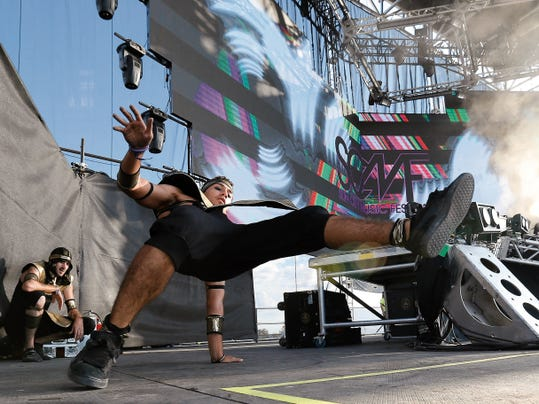 Breakdancers perform on stage at the Sun City Music Festival.