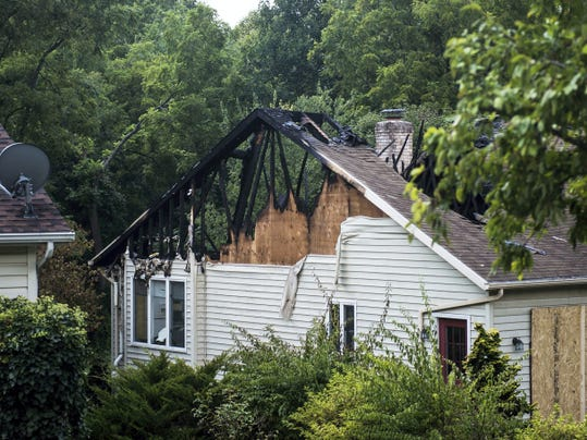 Sunday's fire displaced a family living on Collins Circle in Penn Township. The damage was photographed on Monday afternoon.
