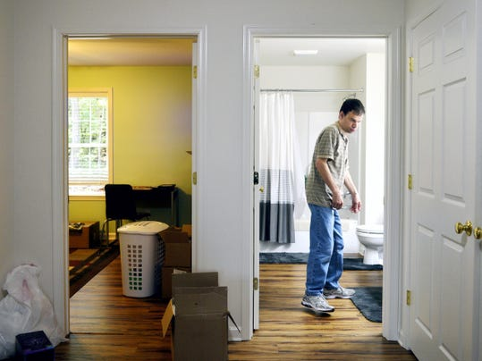 Harold Hebel, 48, gets situated in the bathroom next to his new house built by Penn-Mar Human Services on his family's Shrewsbury Township property. He moved into the new group home, which will house four others, on Wednesday, fulfilling his late-parents' wish that he would have a home on the land he grew up on.