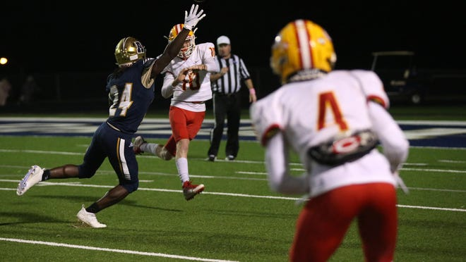 Clarke Central's Will Robinson  (10) passes the ball to Clarke Central's Antonio Jewell (4) with coverage from Apalachee's Marcus Streeter during a GHSA football game at Apalachee.
