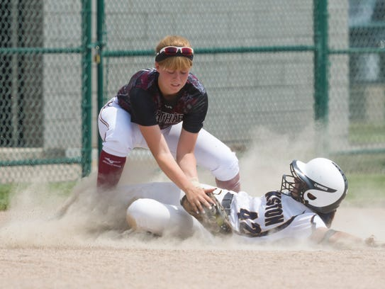 Walled Lake Northern's Jenna Kroll, on defense, batted