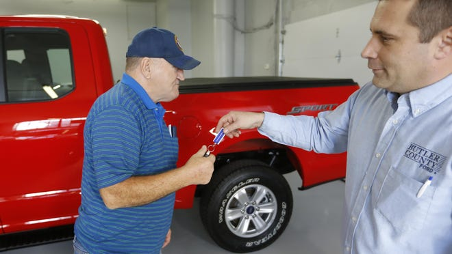 Alton John, left, gets the keys to his new truck from salesman Robert Myers at Butler County Ford in Butler, Pa., last year. Angst about haggling has spawned a small but growing trend toward no-haggle alternatives.