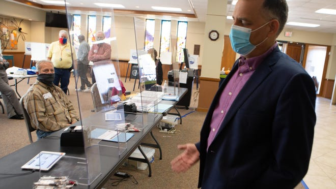 Shawnee County election commissioner Andrew Howell shows the precautions in place for voters Tuesday at First United Methodist Church, 600 S.W. Topeka Blvd.