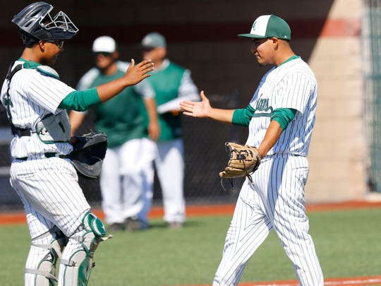 Alisal relief pitcher Ruben Gomez, right, celebrates with catcher and starting pitcher Sal Lopez after defeating Milpitas 6-2 in a CCS Division I quarterfinal game at Hartnell Community College.