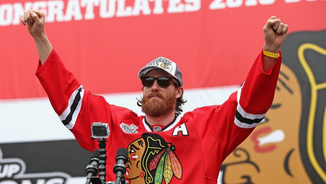 Duncan Keith of the Chicago Blackhawks acknowledges the crowd during the Stanley Cup championship rally at Soldier Field on June 18, 2015, in Chicago.