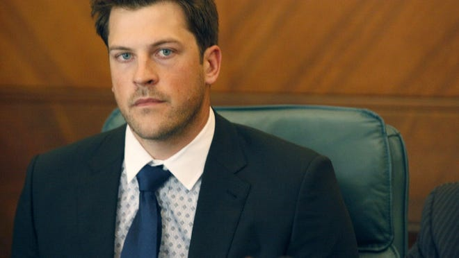 Detroit Tigers pitcher Evan Reed listens to a question from the media July 30, 2014, after he was arraigned in 36th District Court in Detroit on sexual assault charges.