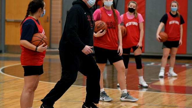 Bedford girls basketball coach Bill Ryan gives instructions during a recent practice.