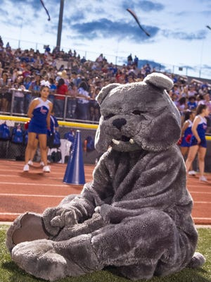 The Las Cruces High School's mascot takes a breather after the Bulldawgs scored another touchdown Friday night at the Field of Dreams. 8/25/17Gary Mook/ for the Sun-News