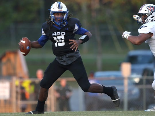 Godby's RaSean McKay scrambles out of the pocket against Wakulla during a game at Cox Stadium.