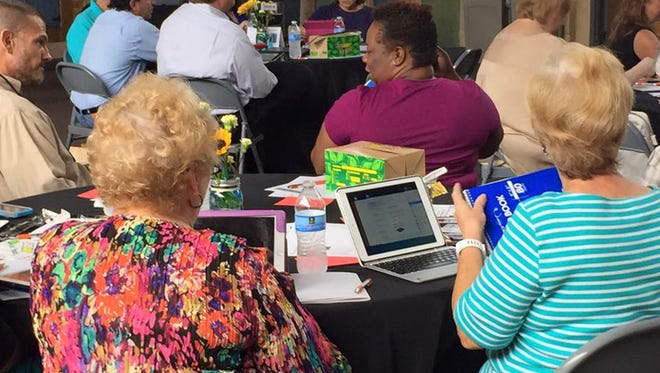 A Lunch and Learn crowd in Pike Road receives the latest scoop on Ipad tips and tricks during a gathering for business and organization leaders.  An upcoming March 17 meeting will focus on business etiquette.