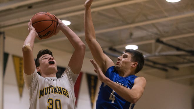 Sayreville's Ryan O'Leary tries to block shot by Marlboro's Dylan Kaufman. Sayreville defeats Marlboro in NJSIAA State Playoff game in Marlboro, NJ on March1, 2017.