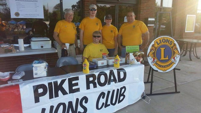 Pike Road Lions Club volunteers serve homemade refreshments at a Pike Road Community Yard Sale in front of Town Hall.