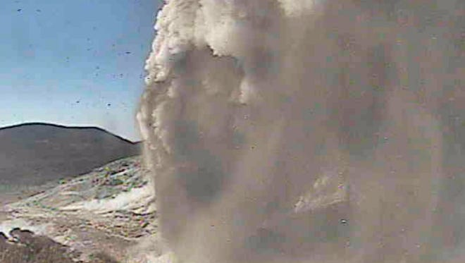 A handout video grab taken from the Japan Meteorological Agency (JMA) live camera website shows the eruption of Mount Io in Miyazaki Prefecture, southwestern Japan, April 19, 2018.