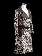 A zebra-pattern coat dress (Lilli Ann), 1960s, made with knit fabric with a leather collar and pocket trim and belt is from the collection of Gary Westford of Salem.
