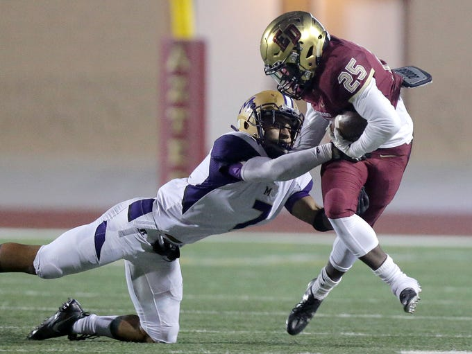 El Dorado running back Seth Davis is caught from behind