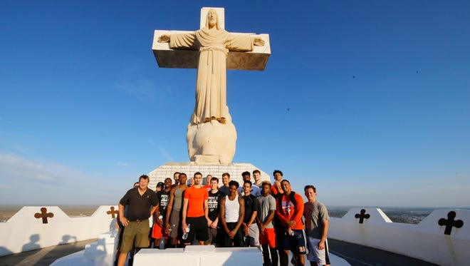 "Members of the UTEP basketball team and coaches stand at the top of Mt. Cristo Rey Friday morning after they climbed to the top as a team during a team building exercise. Floyd told his team ""what we're trying to achieve we're going to do it as a team not individuals."""