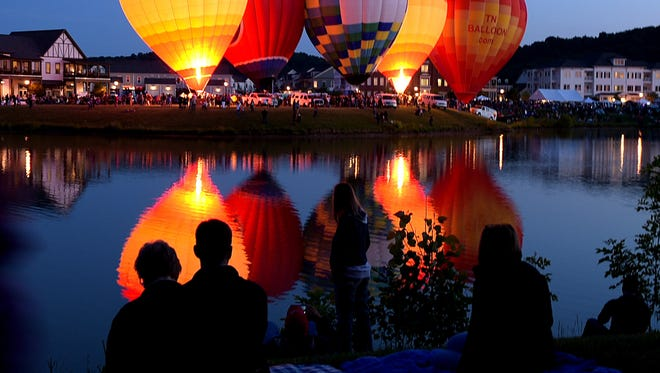 Franklin Hot Air Balloon Festival attendees enjoy the glowing hot air balloons as the sun set around the lake at Westhaven.