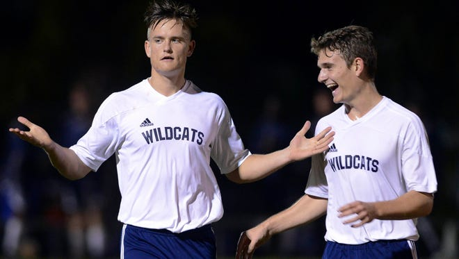 Nick Burgess celebrates his second goal of the evening with teammate Sam Leighton (10) during Wednesday's regional quarterfinal against Lake Highland Prep.