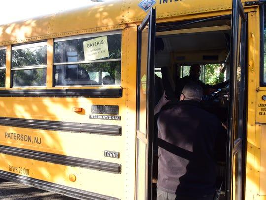 Ledio Llupa, a Paterson public school officer, makes