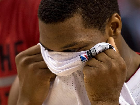 Toronto Raptors guard Kyle Lowry walks off the floor after losing to the Brooklyn Nets in Game 7 of the opening-round NBA basketball playoff series in Toronto, Sunday, May 4, 2014. (AP Photo/The Canadian Press, Frank Gunn)