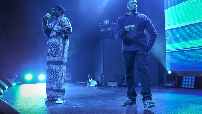 """Rappers Snoop Dogg, left, and Dr. Dre perform at HOT 97's """"The Tip Off"""" at Madison Square Garden on Thursday, Feb 12, 2015, in New York. (Photo by Scott Roth/Invision/AP)"""