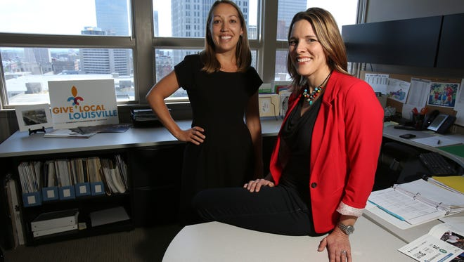 """Give Local Louisville day is intended to promote a  spirit of """"citizen philanthropy"""" in the community, said Cara Baribeau, right, a Community Foundation executive. She works mainly with Anne McKune, the foundation's program officer."""