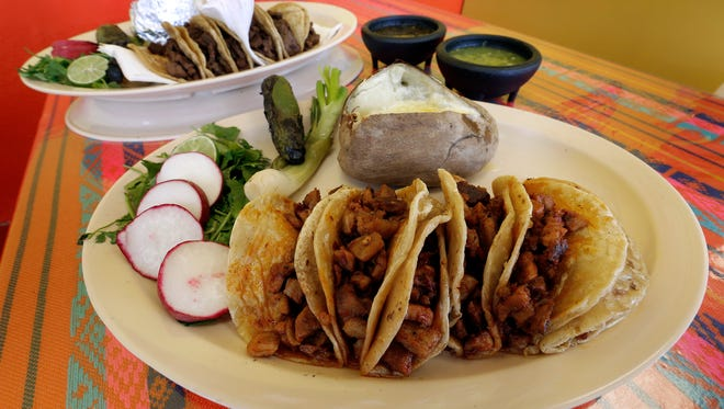 The Tacos Al Pastor, foreground, and the Tacos de Carne Asada are favorites among the patrons at Tacos El Charly in Horizon City.