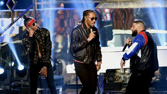 LOS ANGELES, CA - NOVEMBER 20:  (L-R) Rappers August Alsina and Future and DJ Khaled perform onstage during the 2016 American Music Awards at Microsoft Theater on November 20, 2016 in Los Angeles, California.