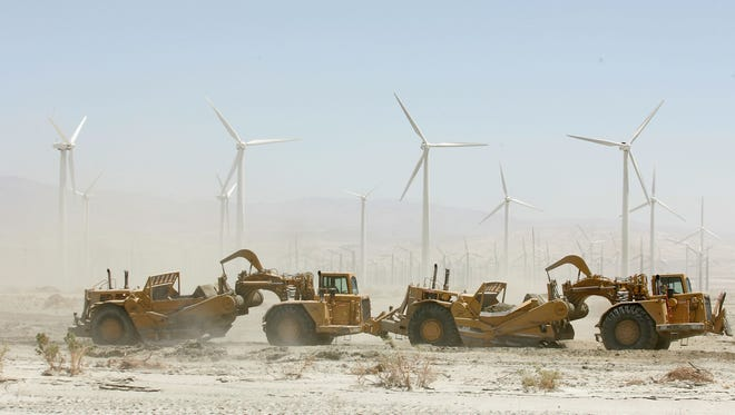 At the groundwater replenishment facility near Palm Springs, large graders remove silt from the percolation ponds so that water can seep into the ground more efficiently.
