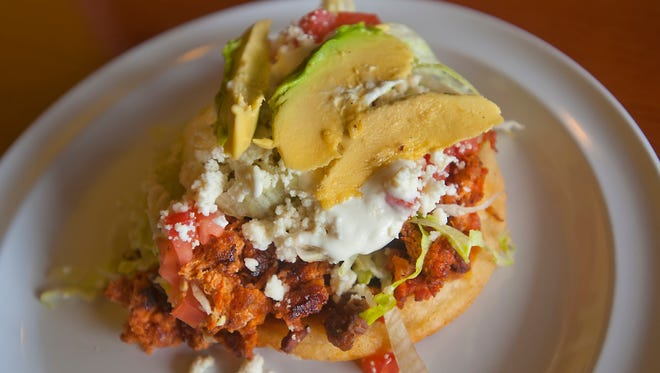 Chorizo sope ($2.49) is made with chorizo sausage, a deep-fried tortilla (sope) and served with tomato, lettuce, queso fresco and avocado.