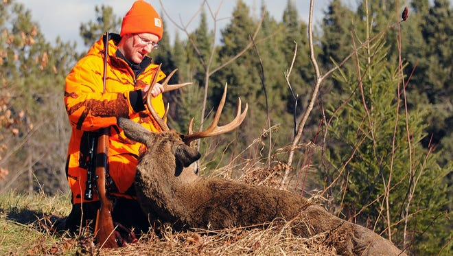 Wisconsin hunters no longer must carry and attach carcass tags to deer and turkeys they shoot, but they still must register their kills by 5 p.m. the next day or face a possible $343.50 fine.