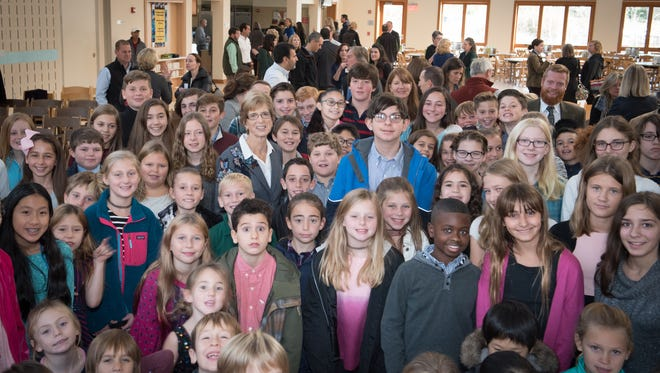"""At the event to commemorate the achievement of their Wellness & Nutrition Center's """"Living Building"""" certification, students at The Willow School in Gladstone celebrate with keynote speaker and former New Jersey Gov. Christie Todd Whitman."""