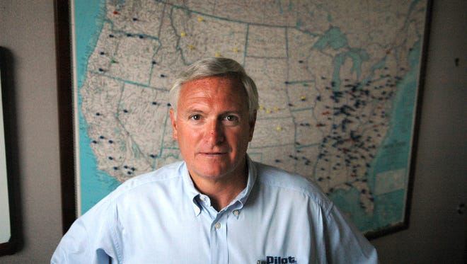 Chief Executive Jimmy Haslam stands in front of a map Oct. 16, 2006, showing where the company's travel centers are located.