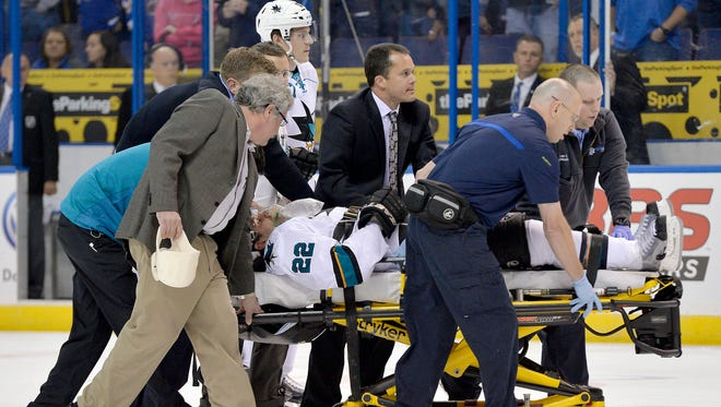 San Jose Sharks defenseman Dan Boyle is taken off the ice after being injured during the first period against the St. Louis Blues.